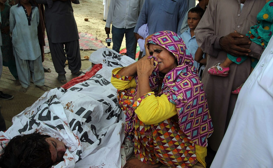 Anwar Bibi, the mother of Qandeel Baloch mourns beside her body. The strangling of Baloch, judged by many in deeply conservative Muslim Pakistan as infamous for selfies and videos that by Western standards would appear tame, has prompted shock and revulsion. Photo: AP.