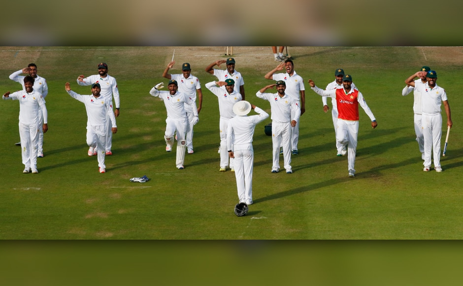 Hats off: How the Pakistan team celebrated their win over England in the first Test at Lord's. Misbah-ul-Haq's side went on an army boot camp before the tour to improve their infamously poor fitness, and senior batsman Younis Khan led the squad in performing a routine of press-ups followed by a military-style salute in front of the ground's famous Pavilion. Reuters