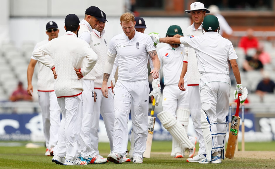 An injured Ben Stokes (centre) walks off the field on Day Four of the 2nd Test at Old Trafford. Reuters