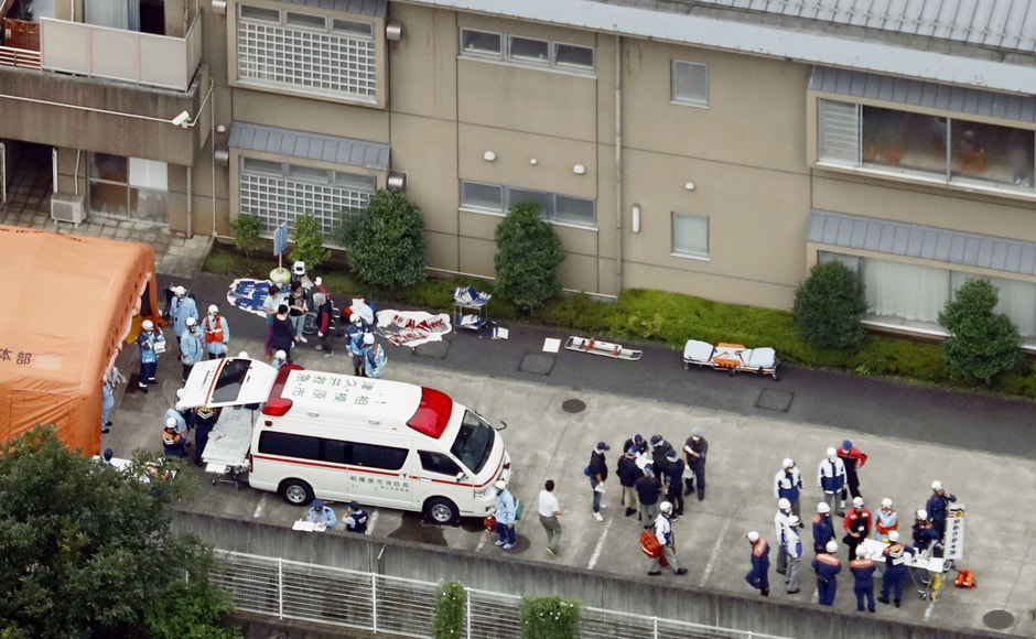 Police officers and rescue workers are seen in a facility for the disabled, where at least 19 people were killed and as many as 20 wounded by a knife-wielding man, in Sagamihara, Kanagawa prefecture, Japan. Reuters/Kyodo.