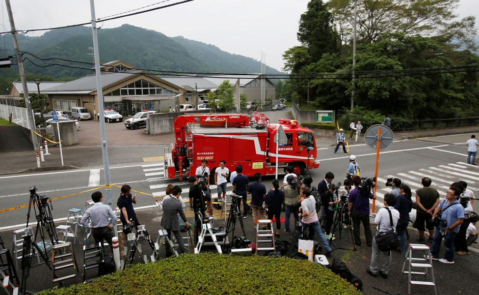 A firefigters' rescue unit car drives in front of a facility for the disabled, where a deadly attack by a knife-wielding man took place, in Sagamihara, Kanagawa prefecture, Japan 26 July, 2016. Reuters/Issei Kato
