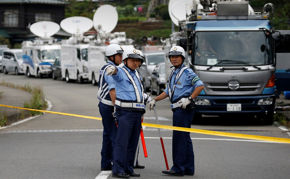 Police officers stand guard at a facility for the disabled, where a deadly attack by a knife-wielding man took place, in Sagamihara, Kanagawa prefecture, Japan, 26 July, 2016. Reuters/Issei Kato