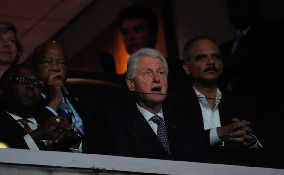 Former President Bill Clinton watches from the audience, along with former Attorney General Eric Holder (R) at the Democratic National Convention. Photo: Reuters