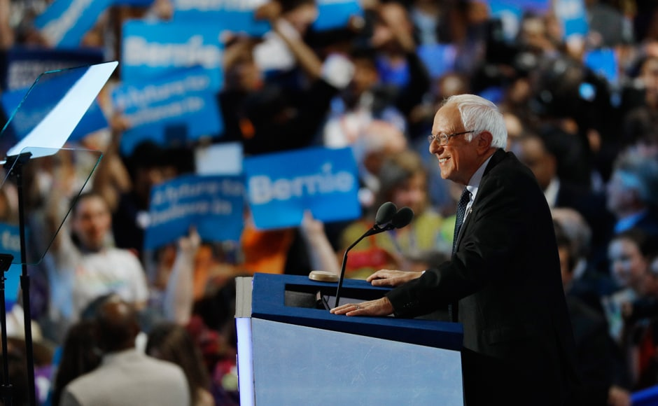 Bernie Sanders robustly embraced his former rival Hillary Clinton on Monday night as a champion for the same economic causes that enlivened his supporters. Photo: Reuters