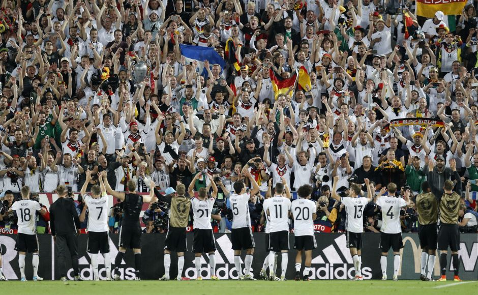 Germany players celebrate in frount of fans after winning the penalty shootout against Italy. Reuters