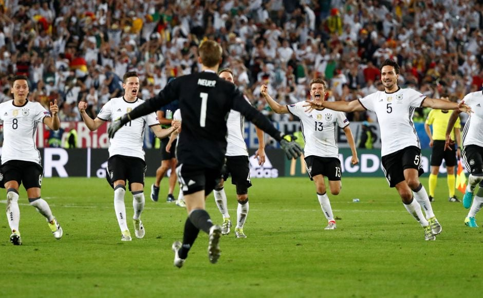 Germany players celebrate winning the penalty shootout against Italy during the Euro 2016 quarterfinal match between Germany and Italy, at the Nouveau Stade in Bordeaux, France. Reuters