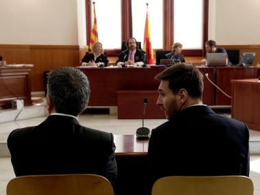 Lionel Messi sits in court with his father Jorge Horacio Messi during their trial for tax fraud in Barcelona. Reuters