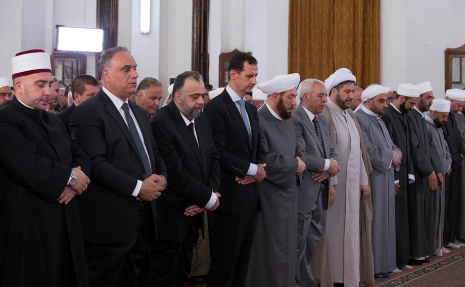 Syria's President Bashar al-Assad (4th L) attends prayers on the first day of the Muslim holiday of Eid al-Fitr, in al-Safa Mosque in Homs, Syria, in this handout picture provided by Sana. Reuters