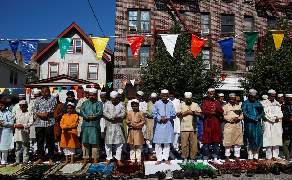 Muslim men attend Eid al-Fitr prayers to mark the end of the holy fasting month of Ramadan in the Queens borough of New York. Reuters