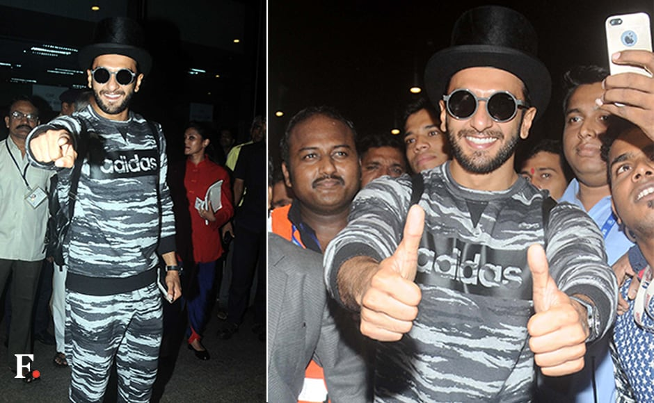 Ranveer spotted wearing a top hat, monochrome sweatpants and John Lennon frames. Sachin Gokhale/Firstpost