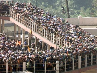 Hindu pilgrims queue outside the Sabarimala Temple where women between the age of 10 to .. are not allowed entry. Reuters