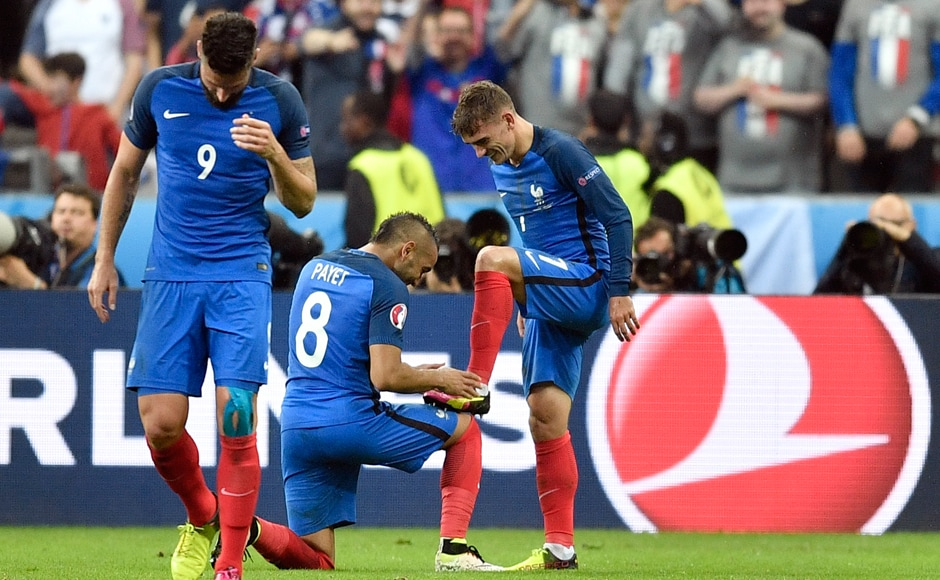 Dimitri Payet before kissing the boot of Antoine Griezmann. Both of them scored against Iceland and look in ominous form ahead of their semi-final clash against the current world champions, Germany. AP