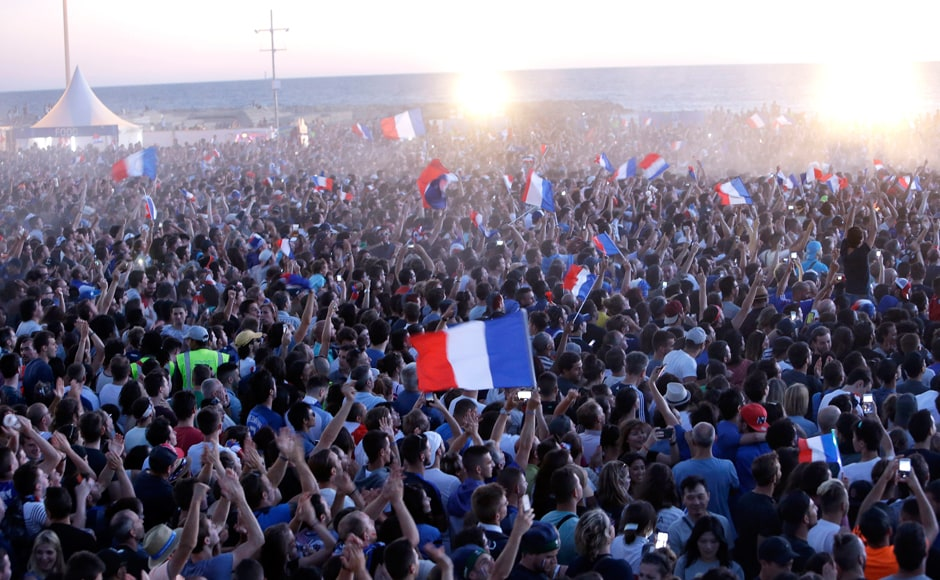 French supporters in Marseille celebrate a goal as fanzones across France played the Euro 2016 QF live on giant screens. AP