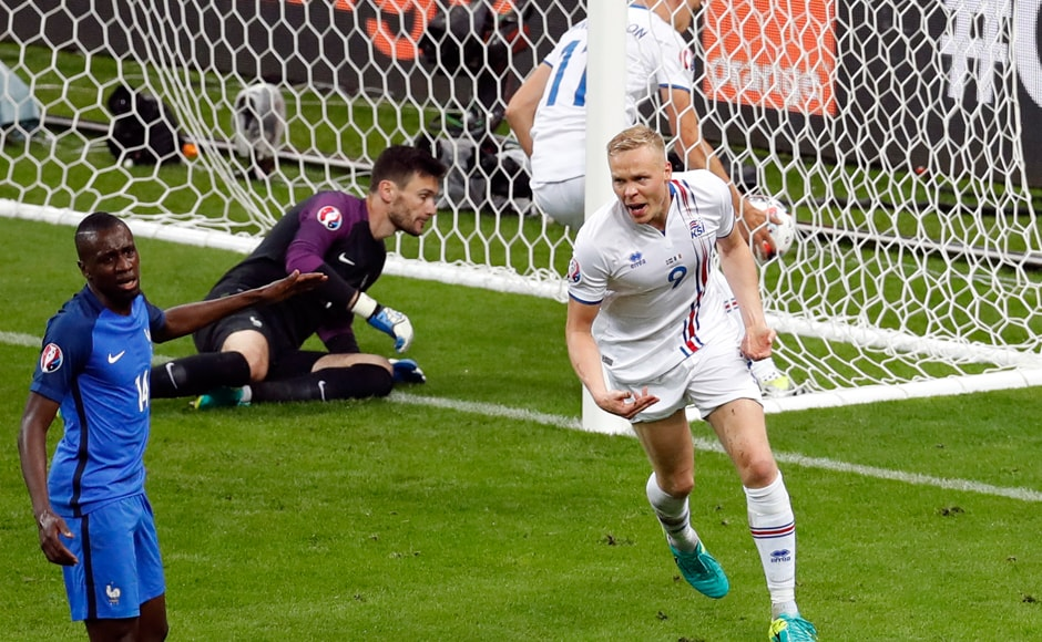 After going down 4-0 at half time, Iceland's Kolbeinn Sigthorsson, celebrates scoring his side's first goal. AP