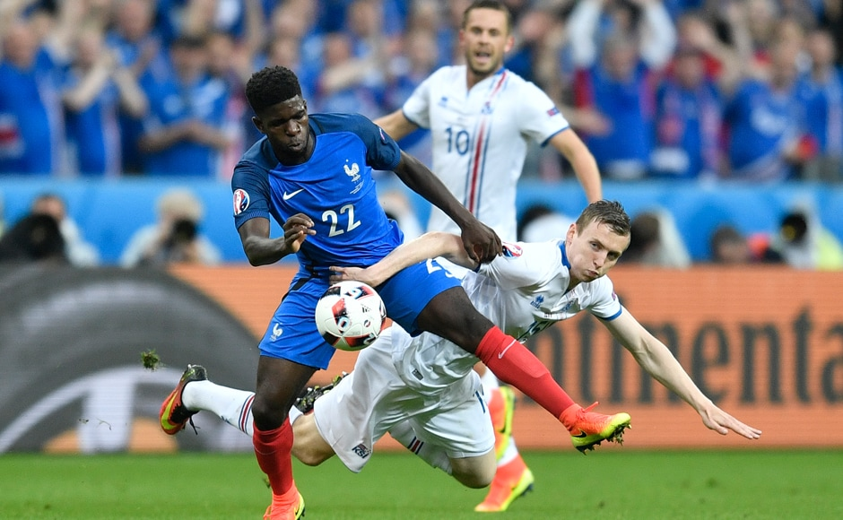 Samuel Umtiti, fights for the ball with Jon Dadi Bodvarsson during the Euro 2016 quarterfinal match between France and Iceland.