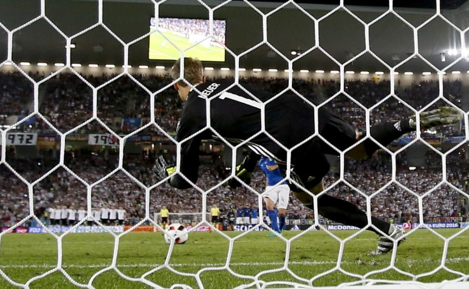 Germany goalkeeper Manuel Neuer saves a penalty by Italy's Leonardo Bonucci during the Euro 2016 quarterfinal match against Italy. Germany beat Italy 6-5 in a penalty shootout. AP