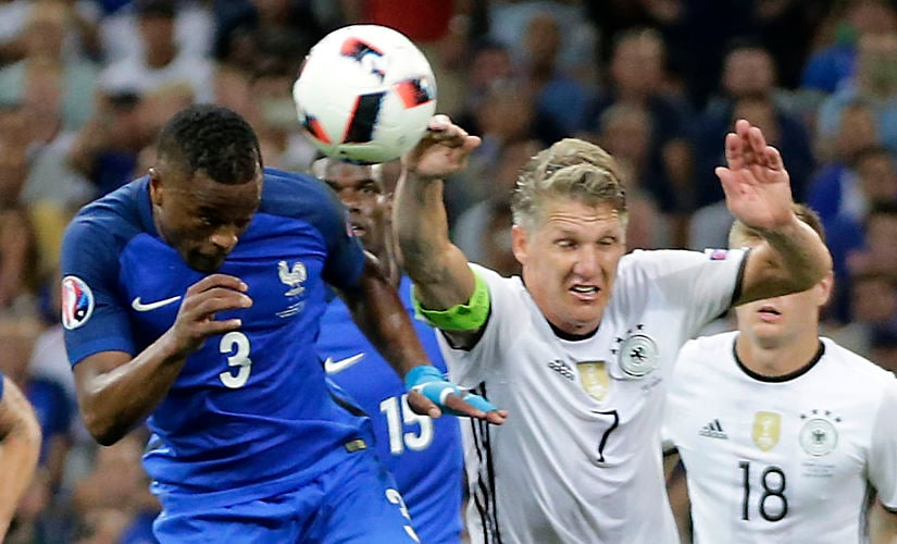 Germany's Bastian Schweinsteiger's handball gifted France a penalty which Antoine Griezmann put away giving them the lead. AP