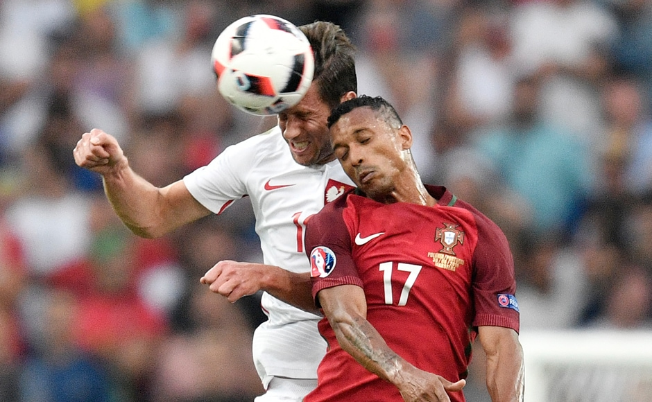Poland's Grzegorz Krychowiak and Portugal's Nani go for a header during the match which ended on a 1-1 draw and went on to a penalty shoot out. AP