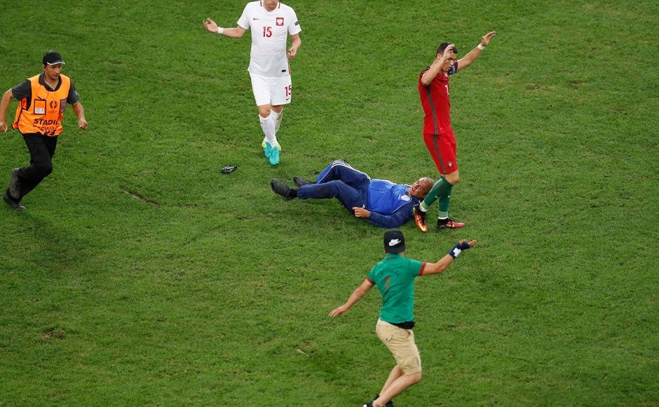 A fan ran into the pitch in the 109th minute and it took fourteen security personnel to carry the Ronaldo fans off after he was caught. AP