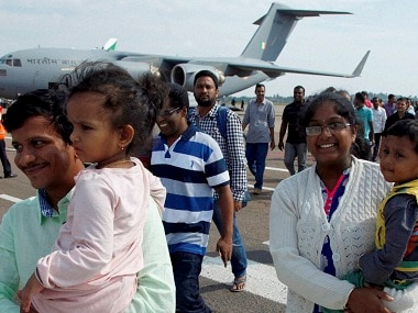 Indian nationals arrive from South Sudan's capital Juba at Entebbe International Airport, about 42 kilometers east of capital Kampala, Uganda. AP.