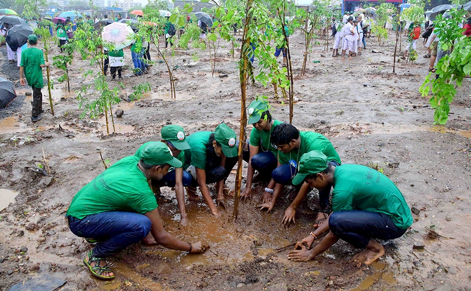Students participate in a tree plantation drive at Maharashtra Nature Park, in Mumbai, on Friday. (Sanket Shinde/ SOLARIS IMAGES)
