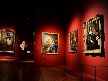 View of paintings and busts representing Louis XIV at the Versailles Palace. Reuters