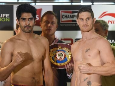 Vijender Singh and Kerry Hope pose after the official weigh-in for the WBO Asia Pacific Super Middleweight title. AFP