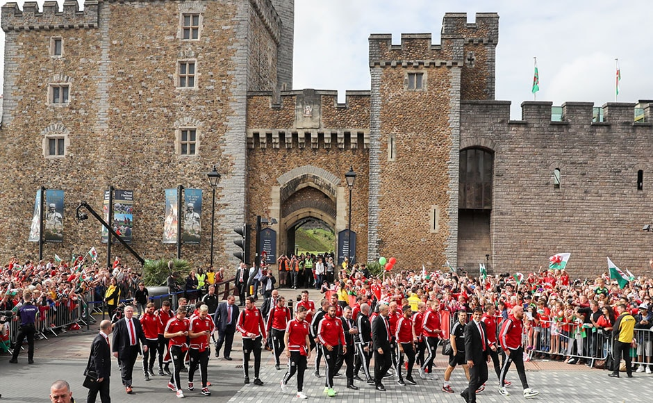 The Welsh team walk to Cardiff Castle and start their open top bus parade on their return home. Getty Images