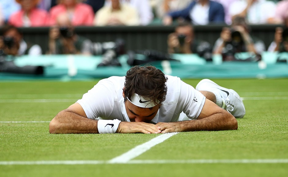 Roger Federer reacts after falling during his semi-final match against Milos Raonic. He stumbled and fell lying face down in the turf of Centre Court, as he battled through five sets but couldn't make it. Getty Images
