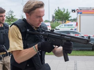 Munich police patrol the streets to find the shooter. DPA via AP