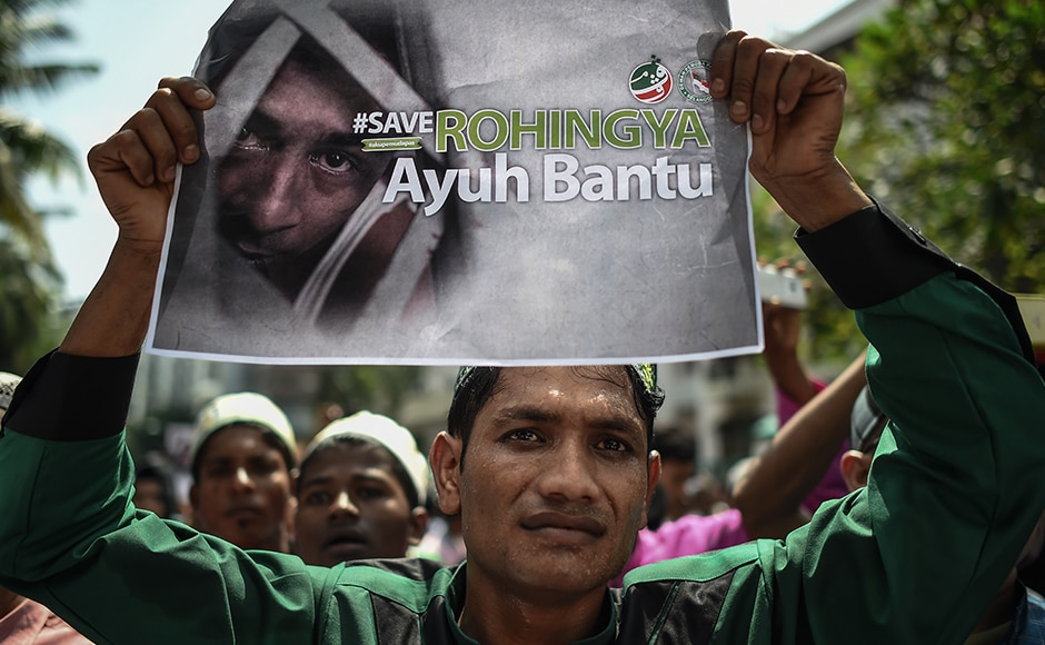 A Myanmar-ethnic Rohingya Muslim, living in Malaysia, protests against their persecution in Myanmar. Photo: AFP.
