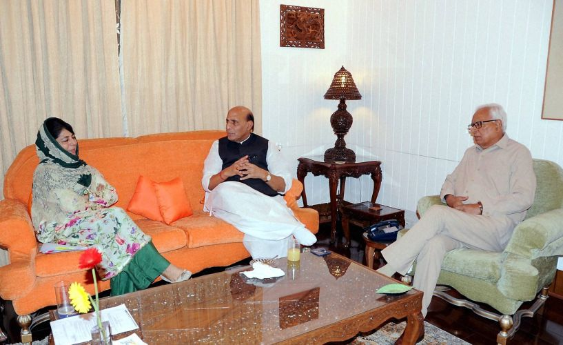 Union Home Minister Rajnath Singh with Governor of Jammu and Kashmir N N Vohra and Chief Minister Mehbooba Mufti during their meeting in Srinagar on Saturday. PTI
