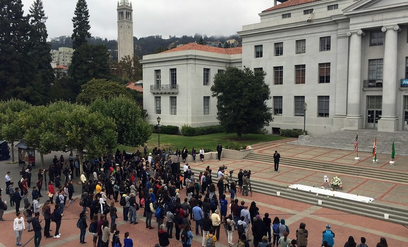 People attend a memorial on the steps of Sproul Plaza at University of California Berkeley on Tuesday, Berkeley, Calif. The university held a vigil for Tarishi Jain, a student who was among the 20 hostages killed by militants in an attack on a restaurant in Bangladesh. AP