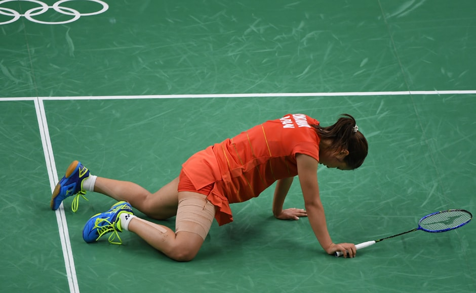 Japan's Nozomi Okuhara reacts against India's PV Sindhu during their women's singles semi-final badminton match. AFP