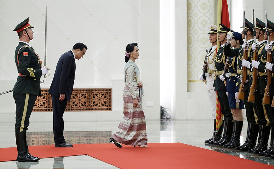 China's Premier Li Keqiang and Myanmar State Counselor Aung San Suu Kyi (3rd L) attend a welcoming ceremony at the Great Hall of the People in Beijing, China on 18 August 18. Reuters