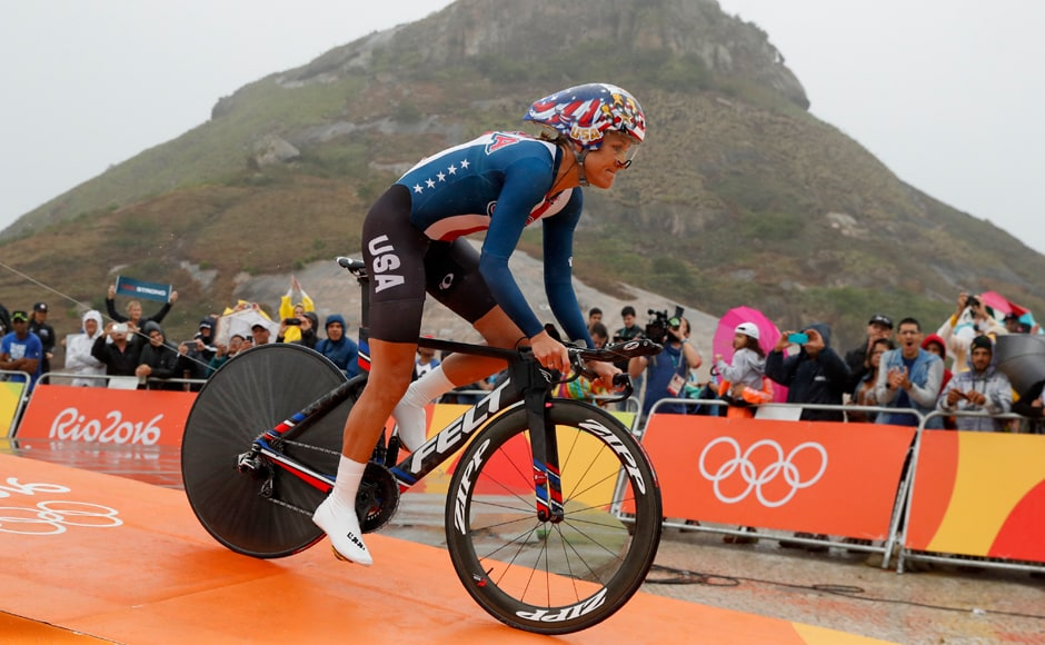 Cyclist Kristin Armstrong of the United States rides at the start of the women's individual time trial event at the 2016 Summer Olympics in Pontal beach, Rio de Janeiro, Brazil. The American cyclist made it three consecutive gold medals on Wednesday, the ageless wonder conquering a brutal course at the Rio Games. Her time of 44 minutes, 26.42 seconds topped reigning bronze medalist Olga Zabelinskaya of Russia by the slimmest of margins: 5.55 seconds. AP
