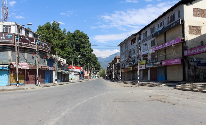 Residency Road in Srinagar, where shops have been shut for a while and no one knows when business will resume. Firstpost/Sameer Yasir