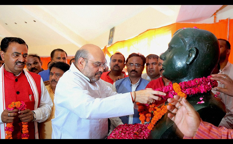 BJP President Amit Shah (centre) pays floral tribute to the great revolutionaries of Kakori in Lucknow. Lashing out at Congress, Shah had claimed that the country has not witnessed any progress since Independence as only