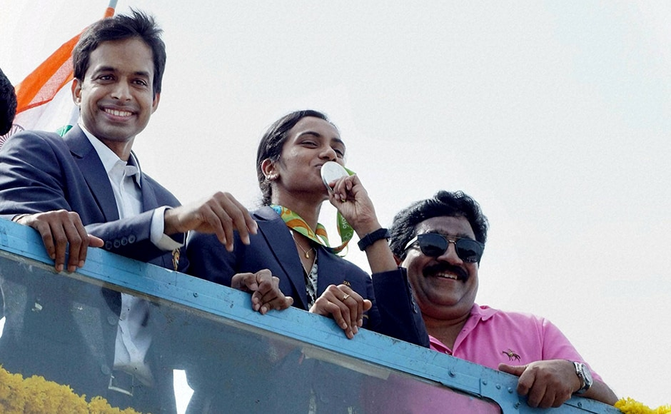 Scores of people had gathered to cheer along the motorcade all along the 30 km route, right from the airport to the stadium. Cheering crowds, some with national flags in their hands, waved to a beaming Sindhu, who seemed to be basking in the glory, at several road junctions along the bus route, to the stadium. Sindhu arrived at the Gachibowli stadium where she facilitated at an official ceremony, following which fans lined up to take selfies with the badminton sensation. PTI