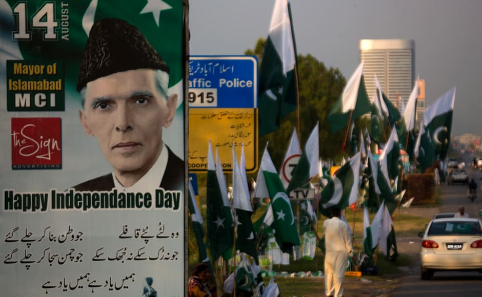 A portrait of Mohammad Ali Jinnah, founder of Pakistan displayed at a roadside where vendors are selling national flags, badges ahead of Pakistan Independence Day in Islamabad on Friday. Pakistan will celebrate its 70th Independence Day on Sunday. AP