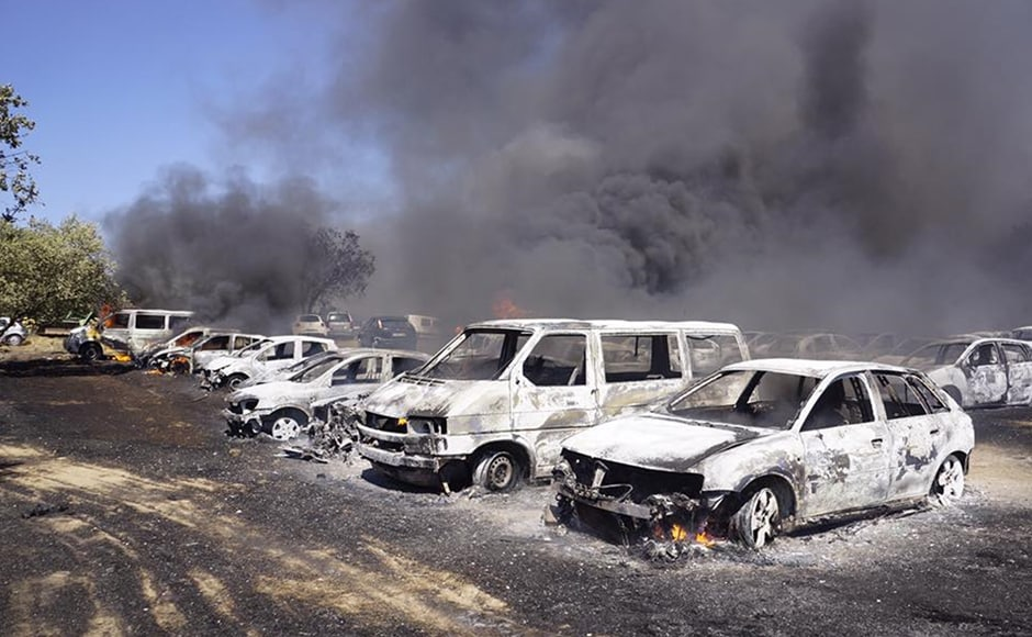 The parking lot resembles a vehicle graveyard after the wildfire gutted 422 cars. AP