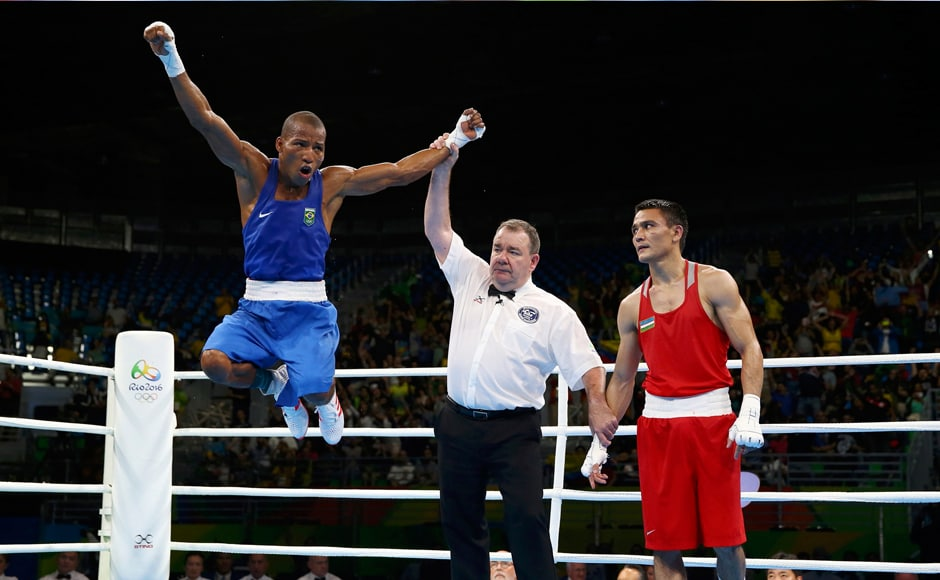 Robson Conceicao of Brazil celebrates after winning his bout against Hurshid Tojibaev of Uzbekistan. Reuters