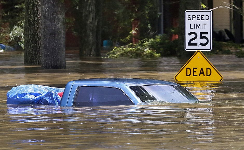 Television images showed residential areas covered in several feet of water, with cars and homes partially submerged. More than 20,000 people had to vacate their homes. Photo: Reuters