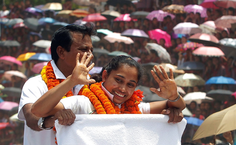 An elated Dipa Karmakar with her coach BS Nandi during her felicitation parade. REUTERS