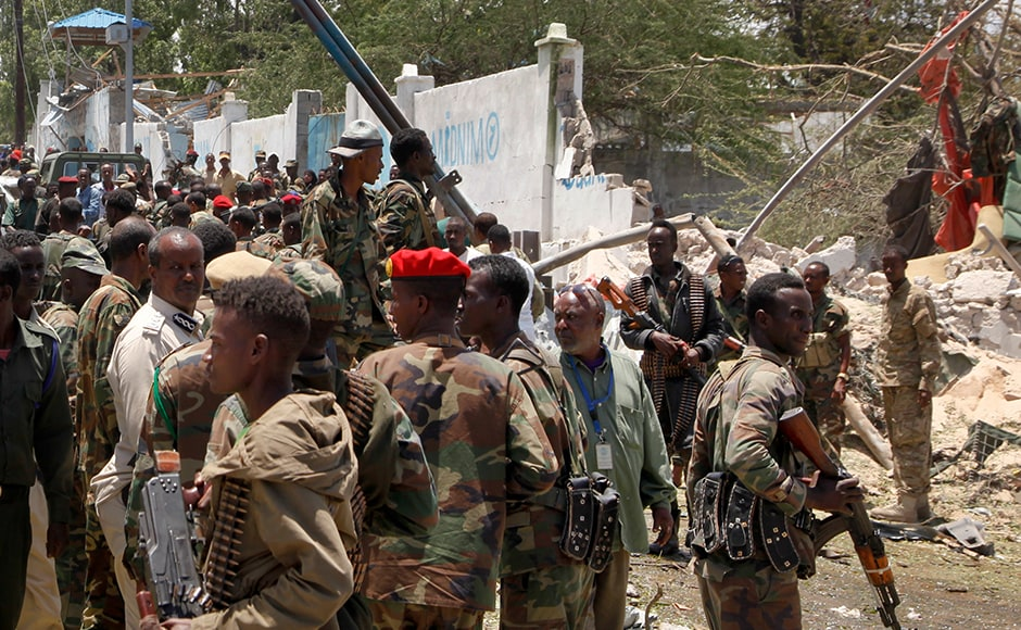 Somali soldiers gathered following the blast while they tried to stop the bomber who used back roads before he sped through checkpoints near the presidential palace and detonated the bomb. The bomber reportedly reached near the gate of the state house with flat tires, according to police sources. AP
