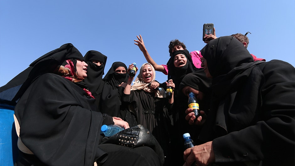 Kurdish television showed footage of jubilant civilians in Manbij, including smiling mothers who had shed their veils, and women embracing Kurdish fighters. One woman burned a black robe that the jihadists had forced residents to wear. Reuters