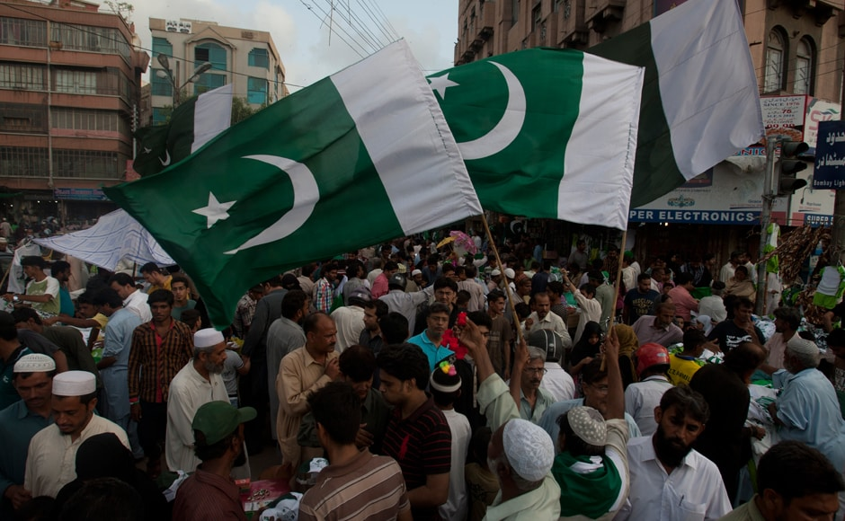 Ahead of the Pakistani Independence Day on 14 August, people buy national flags in Karachi on Thursday. Pakistan will celebrate its 70th independence day on Sunday. AP