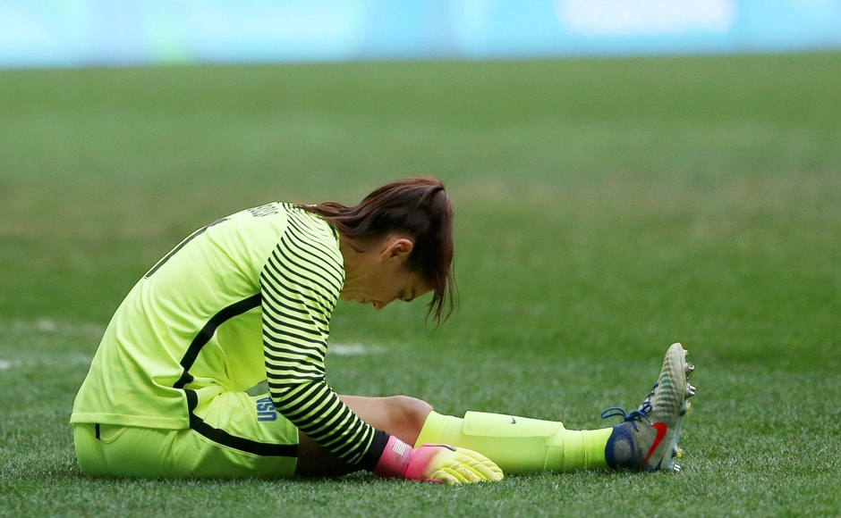 Goalkeeper Hope Solo of USA reacts after losing to Sweden in the women's football quarterfinal. Reuters