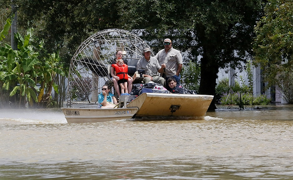 The Louisiana National Guard reported that its soldiers rescued nearly 500 people and 61 pets by boat, helicopter, and using high-water vehicles. Photo: Reuters