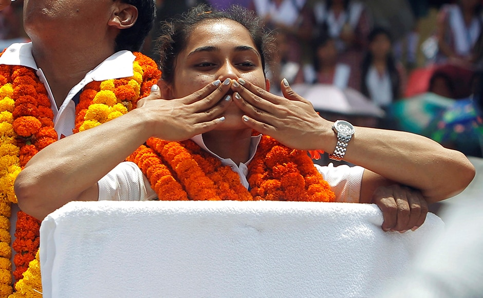 Dipa Karmakar gestures as she stands in a vehicle during her felicitation parade after her return from Rio Olympics. REUTERS